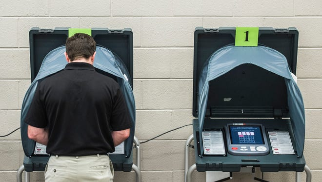 A voter casts his ballot during the Indiana primary election at the First English Lutheran Church vote center on Tuesday, May 8, 2018.