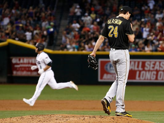 Pittsburgh Pirates' Tyler Glasnow (24) pauses on the mound after giving up a home run to Arizona Diamondbacks' Chris Iannetta, left, during the third inning of a baseball game Friday, May 12, 2017, in Phoenix. (AP Photo/Ross D. Franklin)