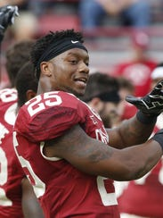 Oklahoma running back Joe Mixon (25) stretches before