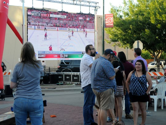 Wichitans watch as the numbers from the bond come in during the bond watch party Saturday, May 5, 2018, on 8th and Ohio Streets.