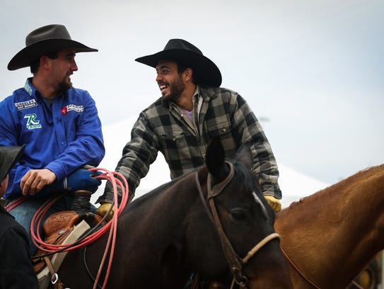 Joel Bach and Josh Torrez warm up their horses for