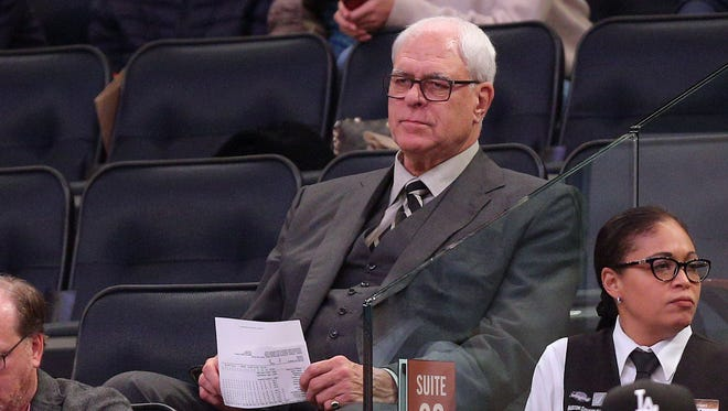 Knicks general manager Phil Jackson watches during the second quarter against the Washington Wizards at Madison Square Garden. Mandatory Credit: Brad Penner-USA TODAY Sports