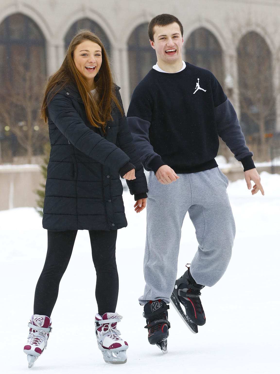 Shayna Raasch, 16, left, and Derek Reiche, 18, both of Weston, ice skate Monday afternoon at The 400 Block in downtown Wausau.