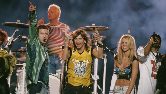 Justin Timberlake of *NSYNC, Joey Kramer and Steven Tyler of Aerosmith, Britney Spears and Nelly perform at the halftime show of Super Bowl XXXV in 2001.