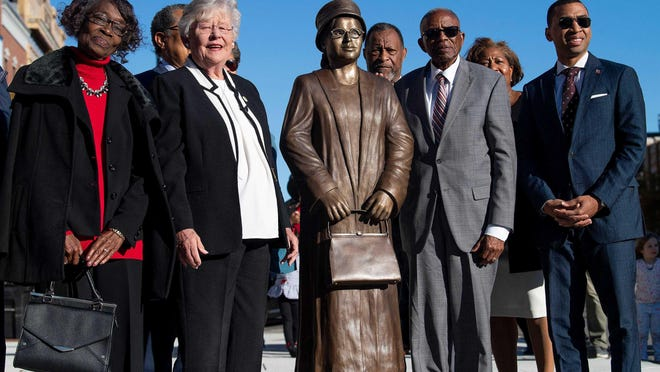 From left, Mary Louise Smith, Alabama Gov. Kay Ivey, civil rights lawyer Fred Gray and Mayor Steven Reed pose after the unveiling of a statue of Rosa Parks in downtown Montgomery, Ala., on Sunday. The unveiling marked the 64th anniversary of when Parks refused to give up her seat on a Montgomery bus to a white man.
