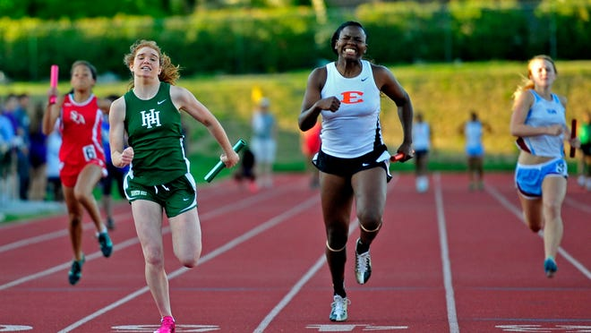 Harpeth Hall's Mary Winston Reames, second from left, finishes the winning leg of the girls' 4x100 relay Friday.