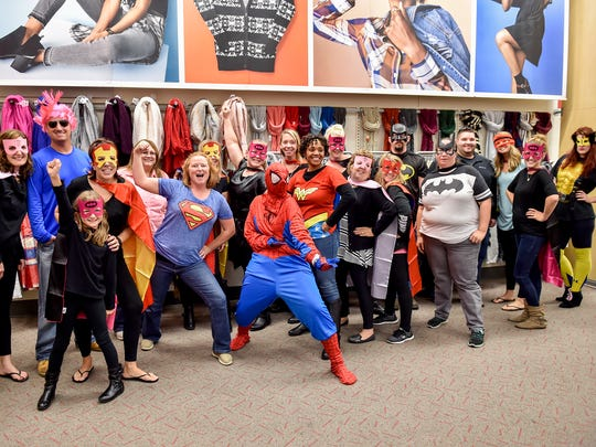 Teachers from Hamilton Heights Elementary dress up as superheroes and participate in Gunnar Downie's Make A Wish at Target on Sunday, Oct. 16, 2016  Chambersburg, Pa. Gunnar's wish was to go on a shopping spree at Target, but first he had to fight villains with his favorite superheroes.