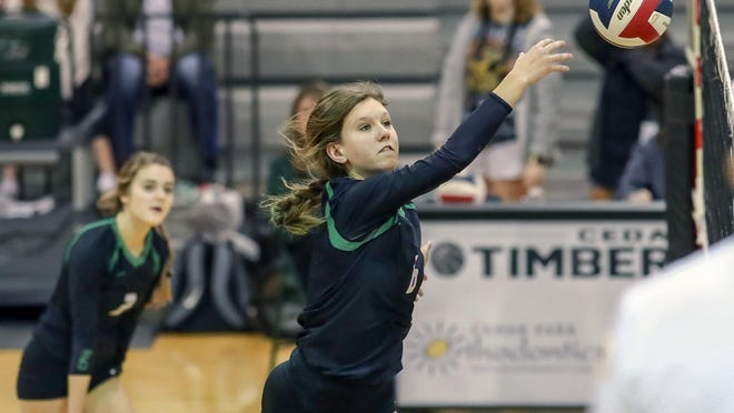 """Cedar Park middle blocker Avery Cole, playing against Connally last fall, would like to travel to Greece someday after hearing stories about the country from her father and uncle. """"One day, I hope to be sitting at the edge of the Parthenon taking in all its architectural glory,"""" she said."""