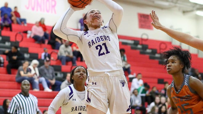 Cedar Ridge forward Lexi Alexander goes up strong to score against Westwood during the 2019-20 season. Alexander scored 26 points with 11 rebounds as the Raiders improved to 2-0 by beating New Braunfels.