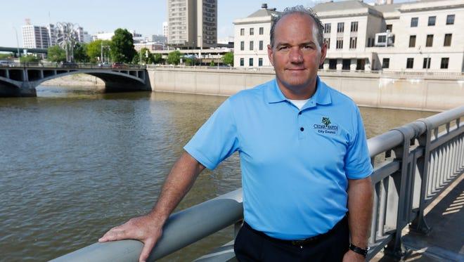 Cedar Rapids Mayor Ron Corbett stands on a bridge over the Cedar River in 2015. At the time Corbett and the city of Cedar Rapids were working with upstream farmers to address water quality issues, hoping to reduce the amount of nitrates in the drinking water.