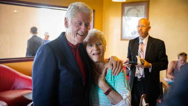 Former United States president Bill Clinton poses at Cafe Milagro with cafe patron Marie Reilly, June 2, 2016. Clinton stopped into the cafe after stumping for his wife, presidential candidate Hillary Clinton, during a rally at Picacho Middle School.