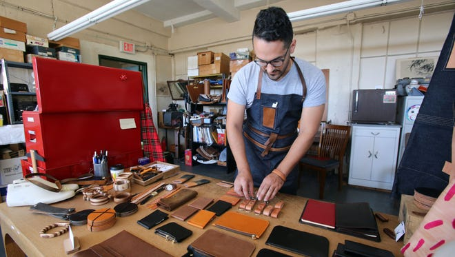 Leather craftsman Matt Demeo organizes his accessories at the Mateo Mattia studios in New Rochelle, which he opened for visitors during the New Rochelle / Pelham Arts Fest Sept. 25, 2016.