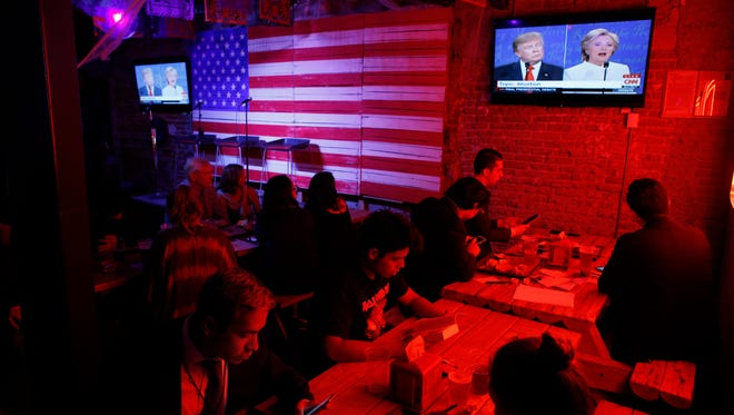 Customers watch the third and last U.S. presidential debate at the Pinche Gringo BBQ restaurant in Mexico City, Wednesday, Oct. 19, 2016. The debate is being held in Las Vegas.