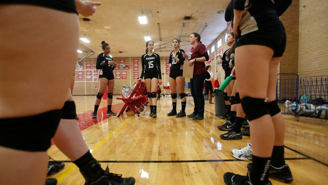 Scarsdale volleyball coach Ann Marie Nee talks to her players during the game against North Rockland at North Rockland High School in Thiells on Oct. 31, 2016.