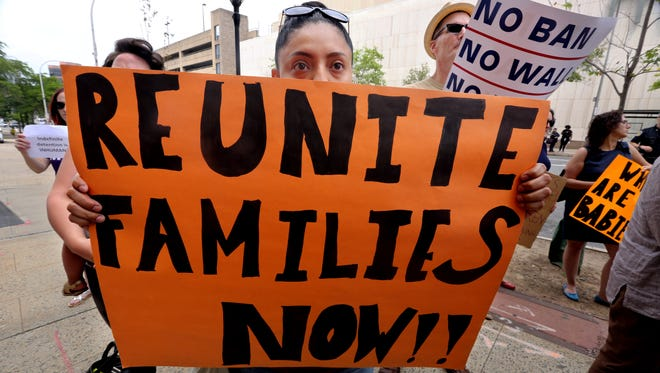 Aida Velesaca of Peekskill was among over one-hundred people who attended a rally for immigrant children in front of the Westchester County office building in White Plains June 22, 2018. Elected officials, clergy, and others spoke out against the Trump administrations policy of forcibly separating immigrant children from their parents. The rally, organized by the Westchester Women's Agenda, concluded with a march to the Martin Luther King, Jr. statue in front of the Westchester County Courthouse.