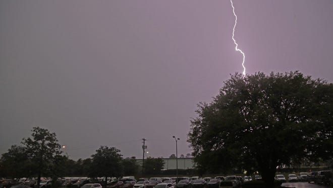 Lightning splits the sky over the Tallahassee Democrat parking lot as severe thunderstorms roll