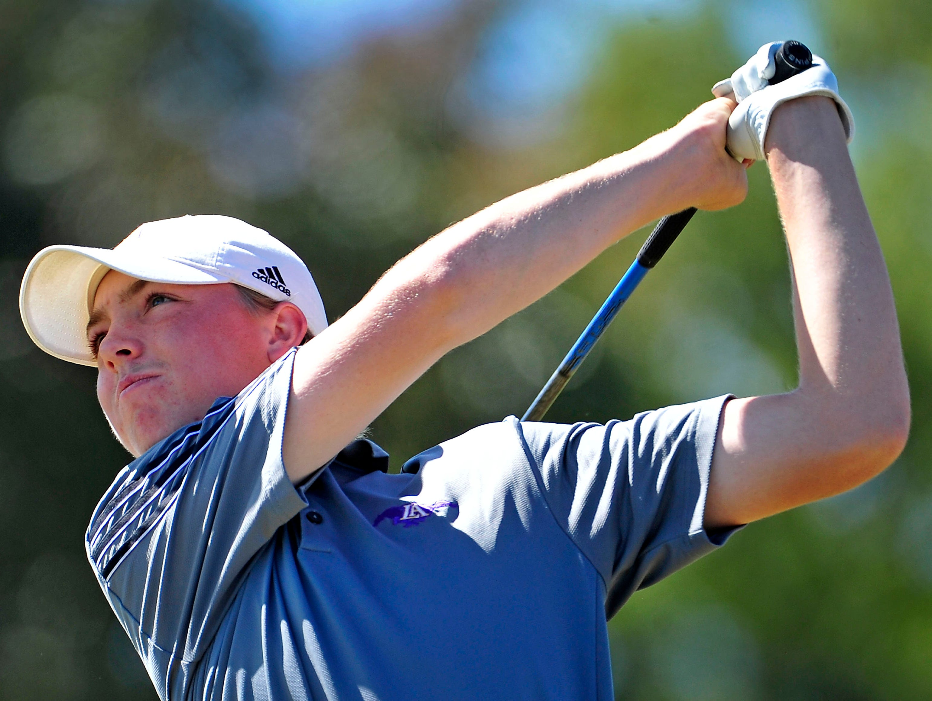 Lipscomb Academy's Davis Armstrong watches his tee shot on the sixth hole during the Class A/AA State Golf Tournament at WillowBrook Golf Club in Manchester, Tenn., Wednesday, Oct. 14, 2015.