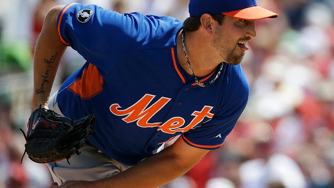 The Mets' Jonathon Niese throws in the first inning of an exhibition game against St. Louis at Jupiter, Fla., on Sunday. Niese left the game with a sore elbow.
