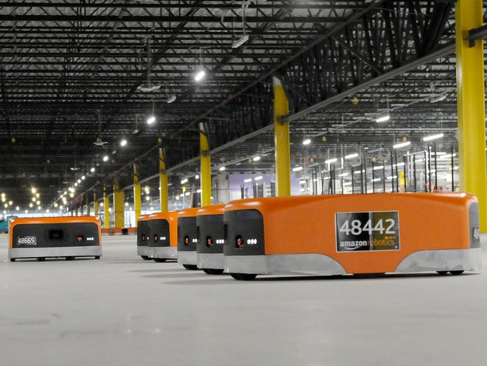 Robots used by Amazon in the fenced in robotics fields.