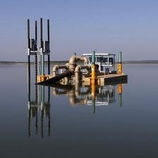 As the water level dropped on Lake Bridgeport, leaving two of three water intakes above the surface, Walnut Creek Special Utility District and Brazos Electric Power Cooperative teamed up to place a pumping barge on the lake.