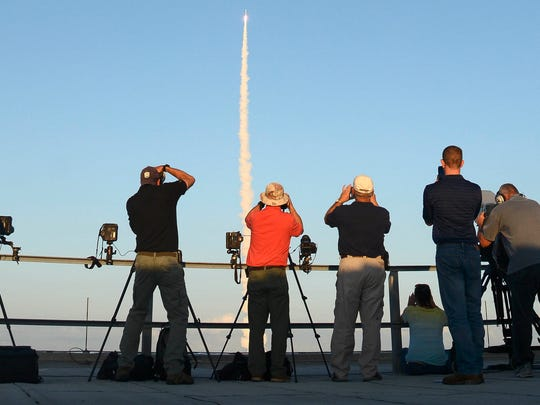 An Atlas V rocket blasts off from Cape Canaveral Air