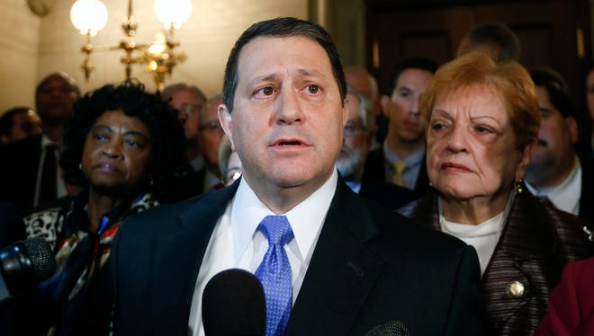 Assembly Majority Leader Joseph Morelle, D-Irondequoit, N.Y., with Democratic members of the Assembly behind him, talks to reporters Thursday, Jan. 22, 2015,  about the arrest of Assembly Speaker Sheldon Silver. Morelle will take over as interim Assembly speaker Monday.