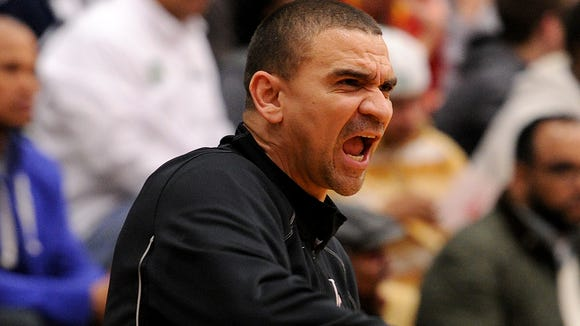 Lawrence Central head coach JR Shelt yells at his team to get back on defense against Arsenal Tech during the Class 4A Sectional #10 at Lawrence North, Friday, March 7, 2014, in Indianapolis. Tech won the game 77-47.