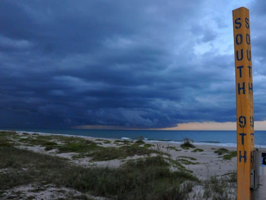 Storm clouds roll out over the ocean in Cocoa Beach