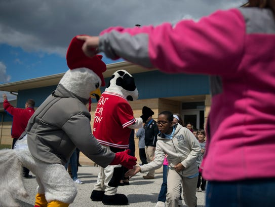 Students are greeted by various mascots as Winslow