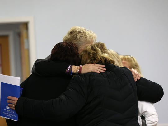 Gates to Recovery ends with a group hug after participants were given instructions in the use of naloxone, a drug that reverses the effects of opioids.