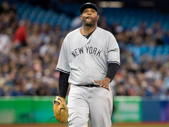 New York Yankees starting pitcher CC Sabathia walks off the mound during the first inning of a baseball game against the the Toronto Blue Jays in Toronto on Saturday, March 31, 2018.