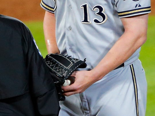 Milwaukee Brewers relief pitcher Will Smith's right arm glistens with sunscreen and rosin. He  was ejected in the seventh inning against the Atlanta Braves on Thursday, May 21, 2015, in Atlanta.