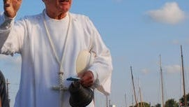 This Daily Times file photo is of the Rev. Henry Zollinhofer as he blesses a fleet of skipjack oyster rigs before the Skipjack Races at Deal Island. On Sunday, Oct. 25, 2015, Zollinhofer is Homecoming guest speak at St. Johns United Methodist Church in Deal Island where he was pastor eight years, until 2002.