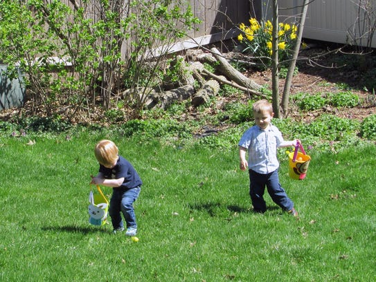 Harrison and Wyatt hunting eggs in their own little