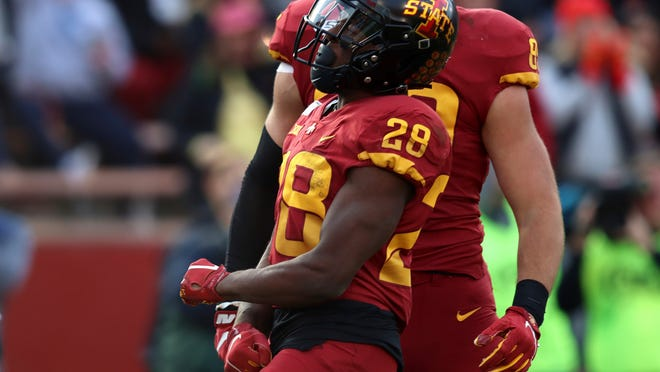Iowa State running back Breece Hall celebrates a touchdown during the second half of an NCAA college football game against Oklahoma State, Saturday, Oct. 26, 2019, in Ames, Iowa. Oklahoma State won 34-27. (AP Photo/Matthew Putney)