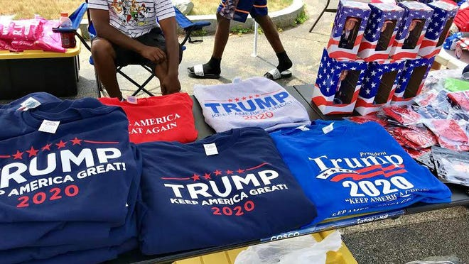 A large Donald Trump traveling merchandise tent was set up off Woodbury Avenue Thursday, marking the start of the frenzy set to descend on the city with the president's visit Saturday.