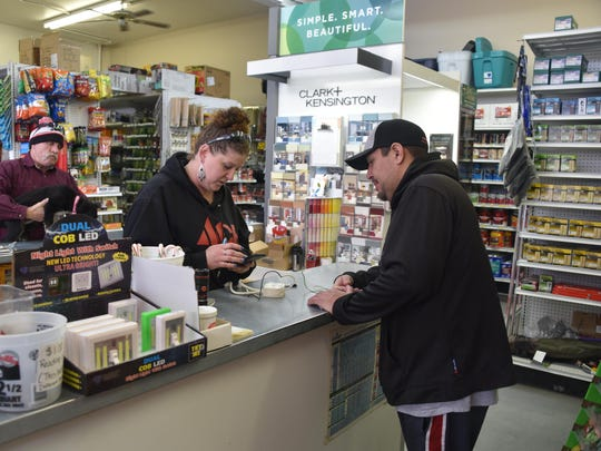 Cheryl Giomi helps a customer during Giomi's Ace Hardware's 45th anniversary celebration last Saturday in Yerington.