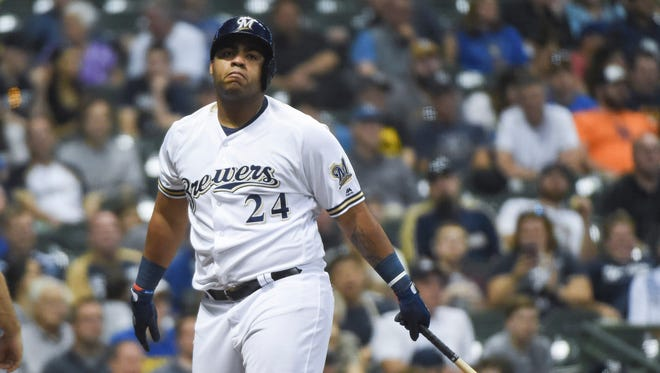 A frustrated Jesus Aguilar walks back to the Brewers dugout after striking out in the sixth inning against Mets starter Steven Matz on Thursday at Miller Park.