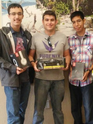 From left: Aboud Alamoudi, Derick Vigne and Erik Leal won the recent hackathon in downtown Fort Myers.