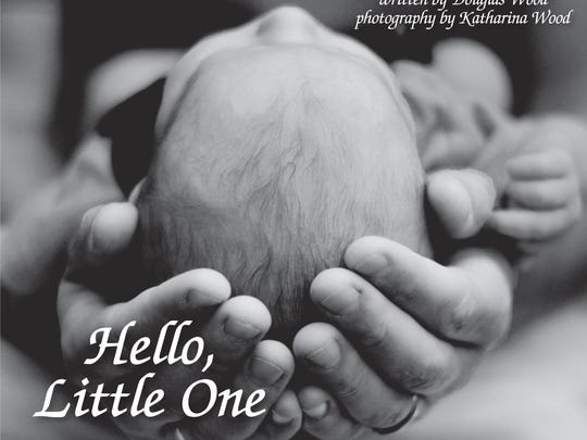 """Hello Little One"" features writing by Douglas Wood and photos by Katharina Wood."