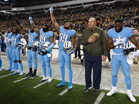The Titans listen to the National Anthem before the start of the game against the Steelers at Heinz Field Thursday, Nov. 16, 2017 in Pittsburgh, Pa.