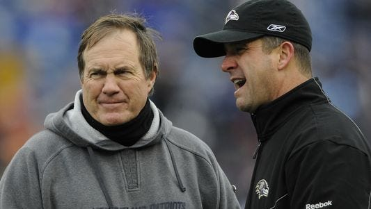 John Harbaugh, right, and the Ravens are 2-2 in postseason against Bill Belichick's Patriots.