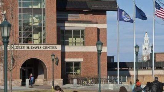Students cross the University of Vermont campus in Burlington.