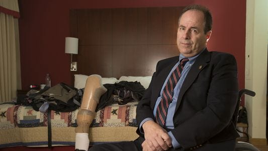 Richard Tremaine, associate director of the Veterans Affairs system in  Alabama, sits in the hotel room where he stays while looking for a handicap-accessible permanent residence on Monday, Jan. 26, 2015. Tremaine and another official at the Alabama system say they were punished for exposing problems affecting patient care.