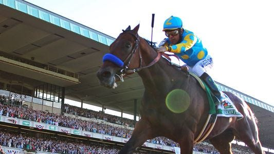 Victor Espinoza guides American Pharoah past the finish line to win the Belmont Stakes and the Triple Crown at Belmont Park.