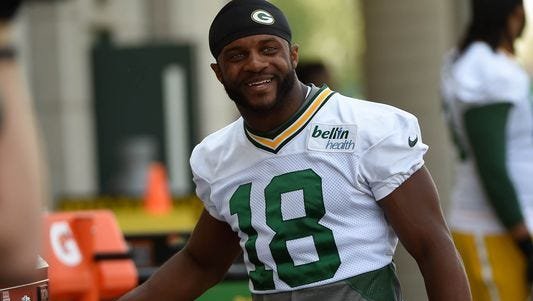 Packers WR Randall Cobb set career bests in catches, yards and TDs in 2014, earning his new contract.