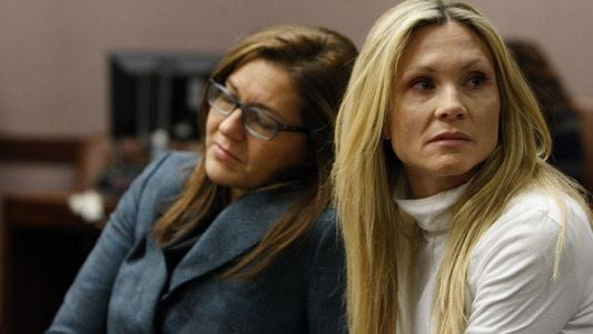 """This Nov. 27, 2012 file photo shows attorney Ellen Torregrossa-O'Connor, left, holding the hand of former """"Melrose Place"""" actress Amy Locane-Bovenizer, 40, of Hopewell Township, N.J. as the jury in her trial returns a verdict in Somerville, N.J. Locane-Bovenizer, who was convicted of vehicular manslaughter in the 2010 crash that killed 60-year-old Helene Seeman, still faces a federal lawsuit. She was sued in federal court by Seemans husband. Fred Seeman's attorney says in a letter Friday, June 19, 2015, that settlement talks have stalled and his client seeks a trial."""