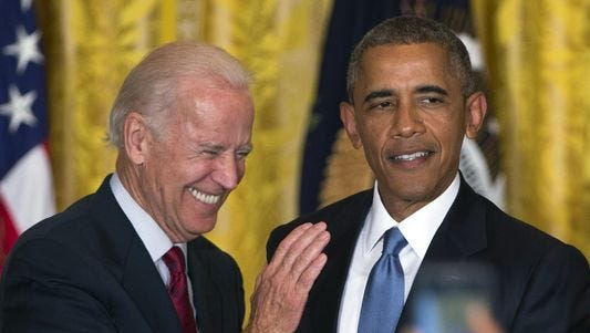 Vice President Biden and President Barack Obama react after a heckler was removed from the East Room of the White House during a reception to celebrate LGBT Pride Month, on Wednesday, June 24, 2015, in Washington.