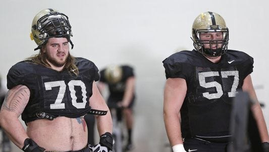 Jordan Roos (70) and Robert Kugler (57) give the Boilermakers plenty of experience on the offensive line heading into the 2015 season.