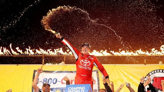 Christopher Bell celebrates after winning the 1-800-CAR-CASH Mud Summer Classic Wednesday night.